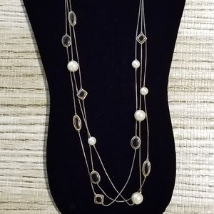 Triple strand white and black necklace